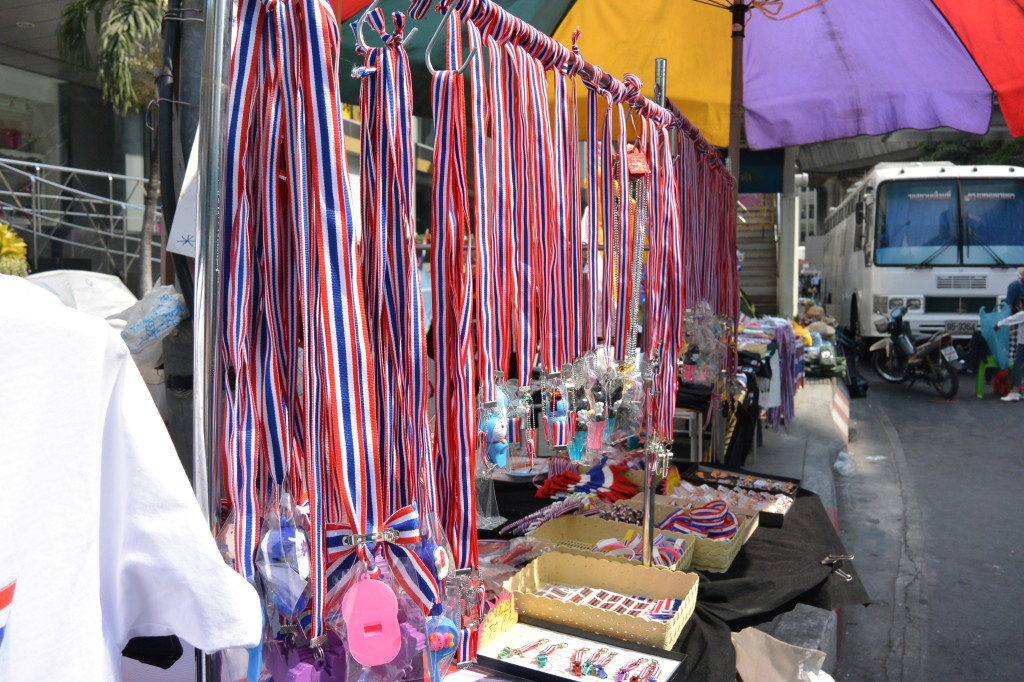 All of the Thai flag coloured ribbons with whistles attached - I bought a miniature version for my keychain.